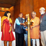 Laxman Gaikwad lighting the lamp